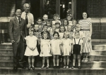 Henry St. John School- Mrs. Mancuso's 1st Grade- Circa 1950 courtesy of Don Darling.Adults L-R: Principal, Mr. Kuppinge