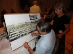 Sylvia Bly brought along an enlarged copy of the 1956 Boynton 8th Grade picture for everyone to sign. Here, Tom Vormwald