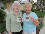 Kathleen Muzzy LaMorte and Phyllis McLaren Sommerman hold the coveted 50th Reunion mugs.