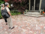 Beverly and Al admire the Hillman's recently-completed flagstone stoop.
