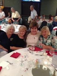 '60 classmates (L-R) Susie Hough, Claire Hernaez, Amalia Stratakos, and Carol Crass at the Saturday banquet.