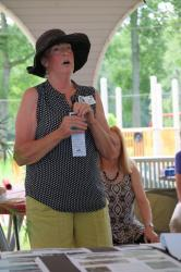 Beverly describes the park's renovation project, at the beginning of the class picnic.